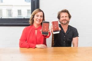 Choovie founders Sonya Stephen and Shane Thatcher holding smart phones with their app on screen